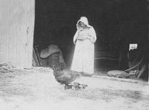 Grandma Cowen feeding Chickens - C.1890